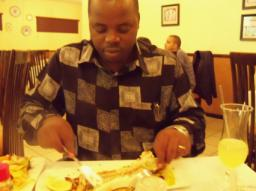 Pastor Matthews eating fish